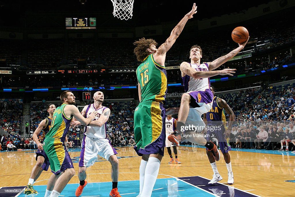 Goran Dragic #1 of the Phoenix Suns goes to the basket against Robin Lopez #15 of the New Orleans Hornets on February 06, 2013 at the New Orleans Arena in New Orleans, Louisiana.