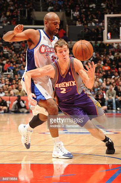 Goran Dragic of the Phoenix Suns handles the ball against Mardy Collins of the Los Angeles Clippers at Staples Center on February 18 2009 in Los...