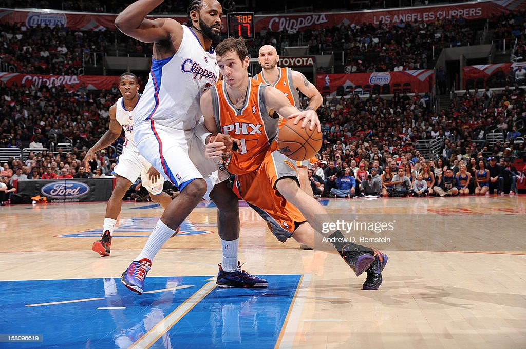 Goran Dragic #1 of the Phoenix Suns handles the ball against Ronny Turiaf #21 of the Los Angeles Clippersat Staples Center on December 8, 2012 in Los Angeles, California.