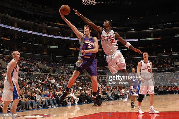 Goran Dragic of the Phoenix Suns has his shot contested by Ricky Davis of the Los Angeles Clippers at Staples Center on October 21 2008 in Los...