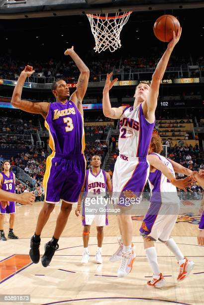 Goran Dragic of the Phoenix Suns lays the ball up against Trevor Ariza of the Los Angeles Lakers during the game on November 20, 2008 at US Airways...