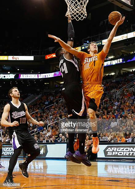 Goran Dragic of the Phoenix Suns lays up a shot past Jason Thompson of the Sacramento Kings during the NBA game at US Airways Center on November 7...