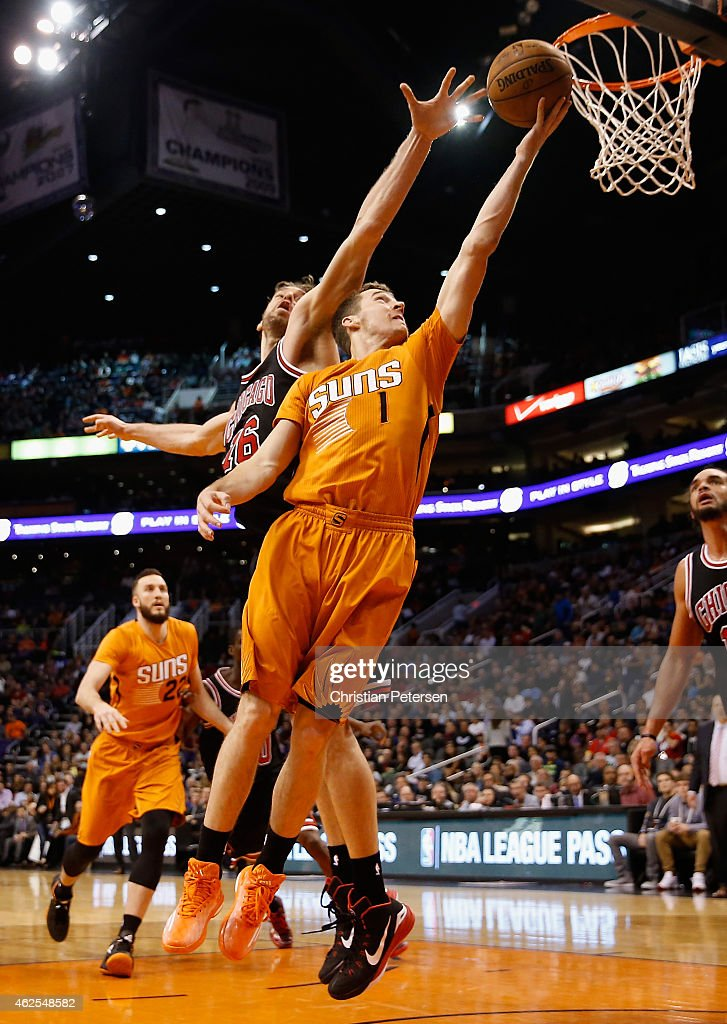 Goran Dragic #1 of the Phoenix Suns lays up a shot past Joakim Noah #13 of the Chicago Bulls during the second half of the NBA game at US Airways Center on January 30, 2015 in Phoenix, Arizona. The Suns defeated the Bulls 99-93.