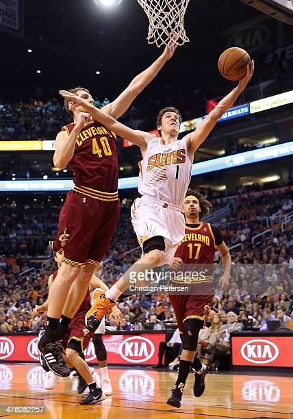 Goran Dragic of the Phoenix Suns lays up a shot past Tyler Zeller and Anderson Varejao of the Cleveland Cavaliers during the second half of the NBA...