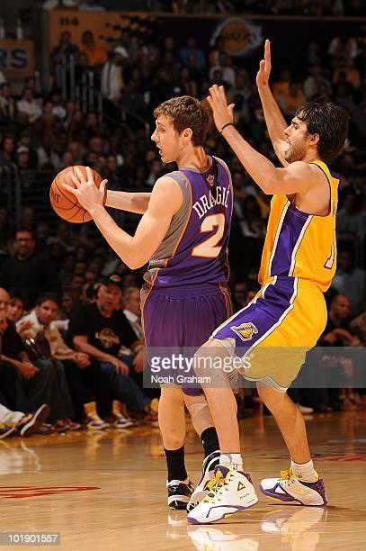 Goran Dragic of the Phoenix Suns moves the ball against Sasha Vujacic of  the Los Angeles 603a9a2ac