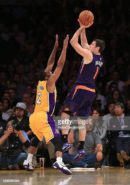 Goran Dragic of the Phoenix Suns shoots a jump shot over Wayne Ellington of the Los Angeles Lakers in the second half during the NBA game at Staples...