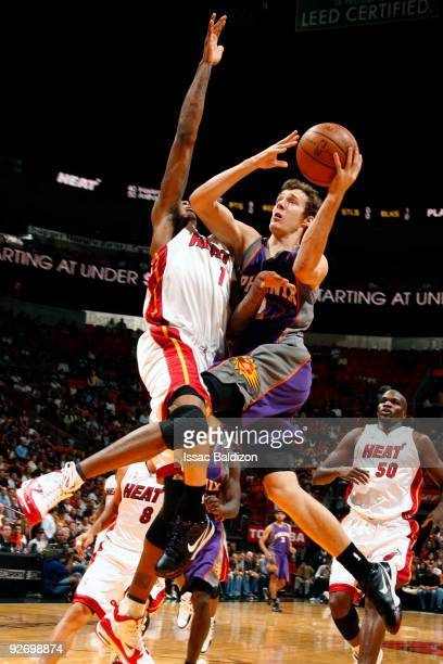 Goran Dragic of the Phoenix Suns shoots against Dorell Wright of the Miami Heat on November 3 2009 at American Airlines Arena in Miami Florida NOTE...