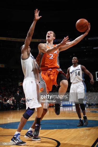 Goran Dragic of the Phoenix Suns shoots against Rashard Lewis of the Washington Wizards at the Verizon Center on January 21 2011 in Washington DC...