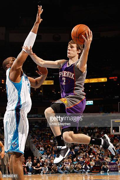 Goran Dragic of the Phoenix Suns shoots the ball over David West of the New Orleans Hornets at the New Orleans Arena on February 1 2010 in New...