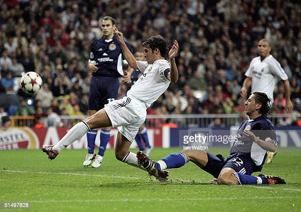 Goran Gavrancic of Dinamo de Kiev tries to tackle Raul of Real Madrid during the UEFA Champions League Group B match between Real Madrid and Dinamo...