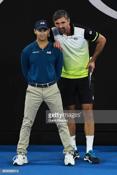 Goran Ivanisevic of Croati interacts with a linesman in his mixed doubles match with Daniela Hantuchova of Slovakia against Mark Philippoussis of...