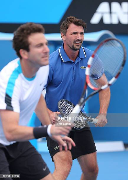 Goran Ivanisevic of Croatia and Justin Gimelstob of United States in action in their legends doubles match during day nine of the 2015 Australian...