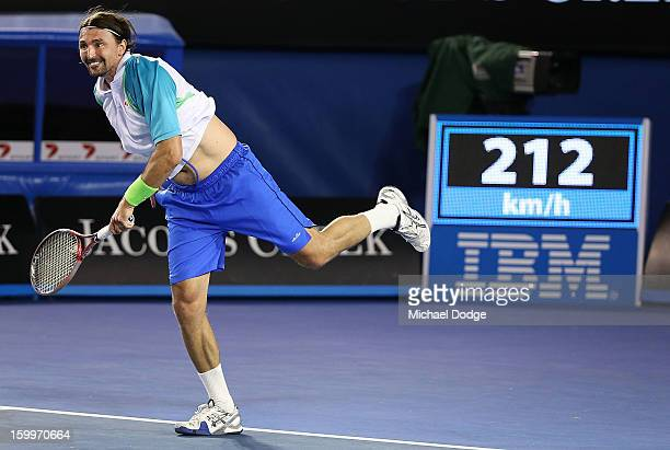 Goran Ivanisevic of Croatia hits a 212 km/h serve during his legends doubles match with Pat Cash of Australia against Henry Leconte and Guy Forget of...
