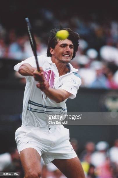 Goran Ivanisevic of Croatia makes a double backhand return against Pete Sampras during their Men's Singles Final match at the Wimbledon Lawn Tennis...