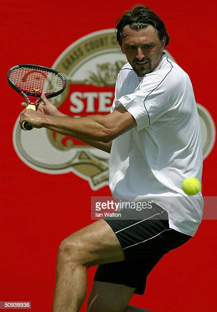 Goran Ivanisevic of Croatia returns the ball during his match against Victor Hanescu of Romania at the Stella Artois Tennis Tournament at the Queens...