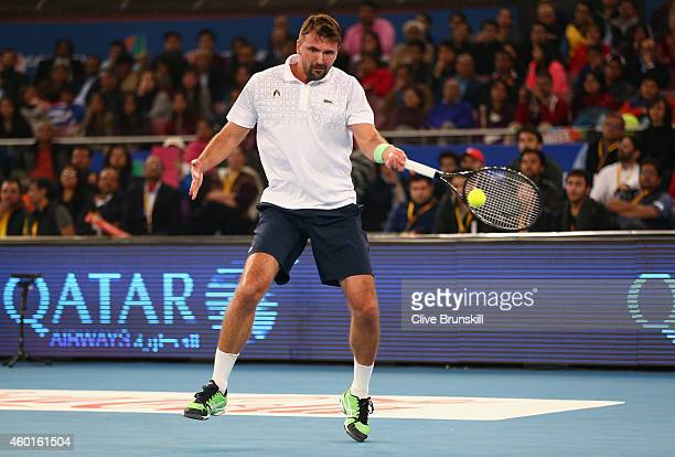 Goran Ivanisevic of the UAE Royals plays a forehand against Fabrice Santoro of the Indian Aces during the CocaCola International Premier Tennis...