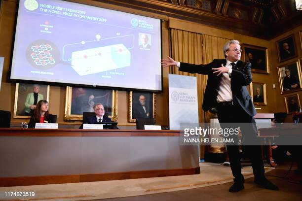 Goran K Hansson Secretary General of the Royal Swedish Academy of Sciences and academy members Sara Snogerup Linse listen to Olof Ramstrom as he...