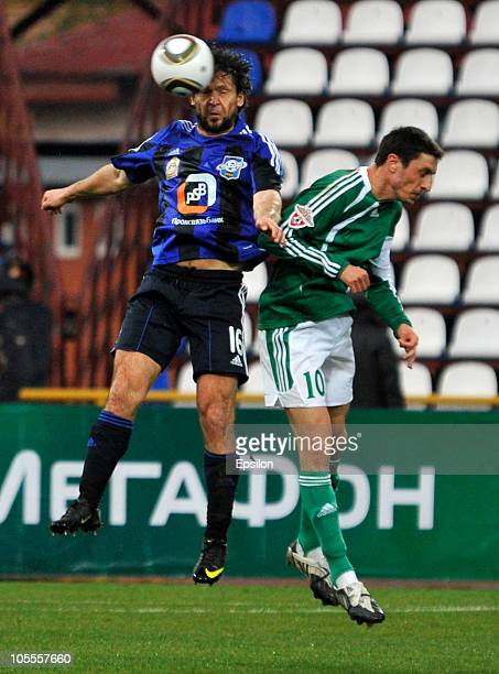 Goran Maznov of FC Tom Tomsk battles for the ball with Vadim Evseev of FC Saturn during the Russian Football League Championship match between FC Tom...