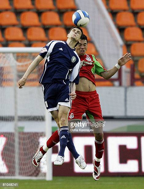 Goran Maznov of FC Tom Tomsk competes for the ball in the air with Rodolfo of FC Lokomotiv Moscow during the Russian Football League Championship...