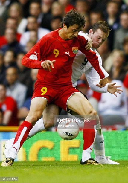 Goran Maznov of Macedonia battles with Wayne Rooney of England during the Euro 2008 Qualifying match between England and Macedonia at Old Trafford on...