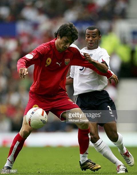 Goran Maznov of Macedonia holds off Ashley Cole of England during the Euro 2008 Qualifying match between England and Macedonia at Old Trafford on...