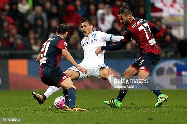 Goran Pandev and Panagiotis Tachtsidis of Genoa CFC battles for the ball with Leandro Paredes of Empoli FC during the Serie A match between Genoa CFC...