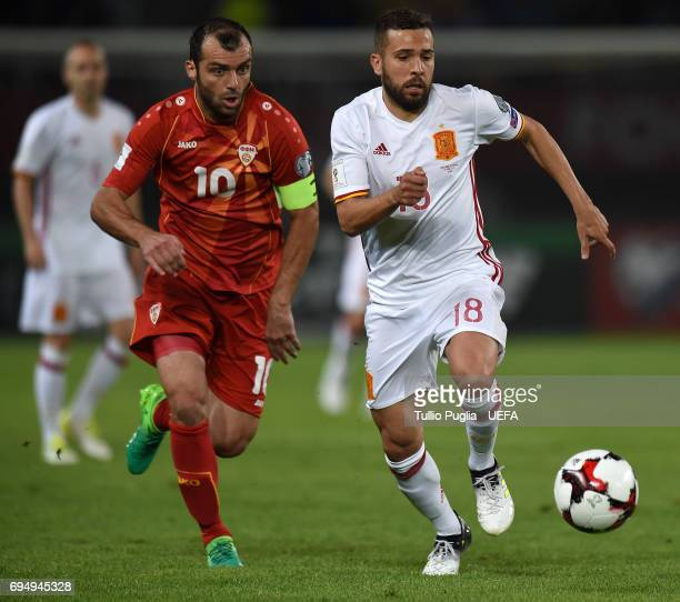 Goran Pandev of FYR Macedonia and Jordi Alba of Spain compete for the ball during the FIFA 2018 World Cup Qualifier between FYR Macedonia and Spain...