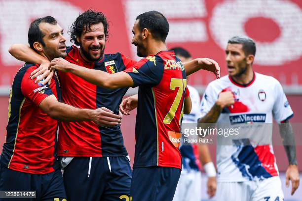 Goran Pandev of Genoa celebrates with his team-mate Mattia Destro and Davide Zappacosta after scoring a goal during the Serie A match between Genoa...