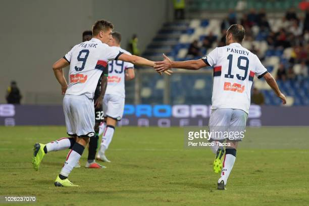 Goran Pandev of Genoa CFC celebrates his first goal with Krysztof Piatek during the serie A match between US Sassuolo a nd Genoa CFC at Mapei Stadium...