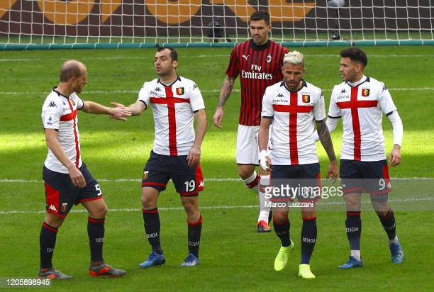 Goran Pandev of Genoa CFC celebrates with his team-mates after scoring the opening goal during the Serie A match between AC Milan and Genoa CFC at...