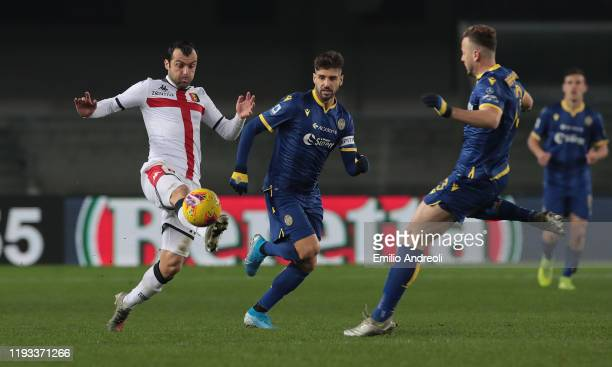 Goran Pandev of Genoa CFC is challenged by Miguel Veloso of Hellas Verona during the Serie A match between Hellas Verona and Genoa CFC at Stadio...