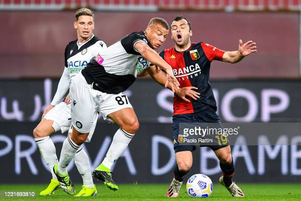 Goran Pandev of Genoa tackled by Sebastien De Maio of Udinese during the Serie A match between Genoa CFC and Udinese Calcio at Stadio Luigi Ferraris...