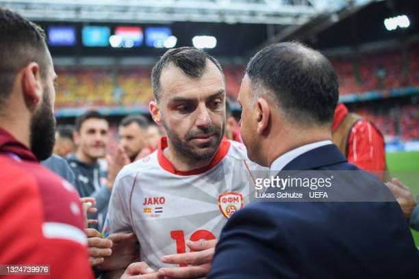 Goran Pandev of North Macedonia is embraced by Igor Angelovski, Head Coach of North Macedonia as he is substituted during the UEFA Euro 2020...