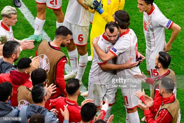 Goran Pandev of North Macedonia is embraced by teammate Feran Hasani as he is substituted during the UEFA Euro 2020 Championship Group C match...