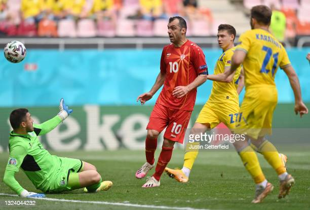 Goran Pandev of North Macedonia scores a goal past Georgiy Bushchan of Ukraine that was later disallowed for offside during the UEFA Euro 2020...