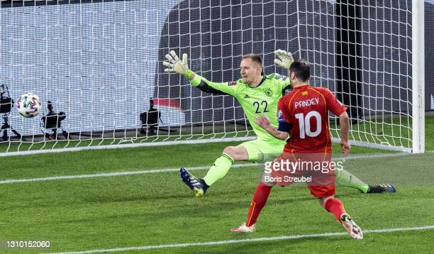Goran Pandev of North Macedonia scores his team's first goal past goalkeeper Marc-Andre ter Stegen of Germany during the FIFA World Cup 2022 Qatar...