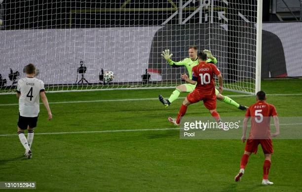Goran Pandev of North Macedonia scores their side's first goal past Marc-Andre ter Stegen of Germany during the FIFA World Cup 2022 Qatar qualifying...