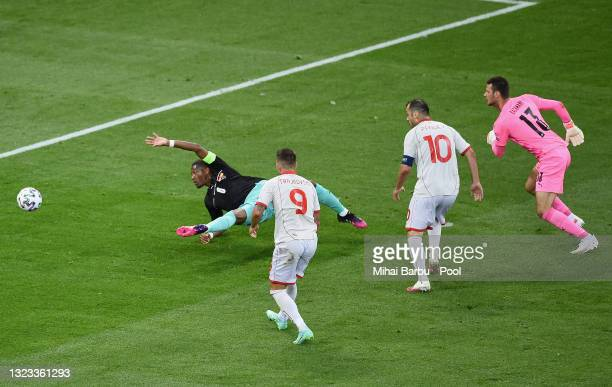Goran Pandev of North Macedonia scores their side's first goal past Daniel Bachmann and David Alaba of Austria during the UEFA Euro 2020 Championship...