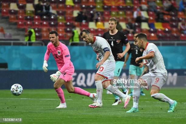 Goran Pandev of North Macedonia scores their side's first goal past Daniel Bachmann of Austria during the UEFA Euro 2020 Championship Group C match...