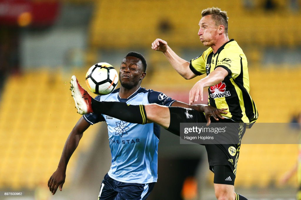 Goran Paracki of the Phoenix and Charles Lokoli Ngoy of Sydney FC compete for the ball during the round 12 A-League match between the Wellington Phoenix and Sydney FC at Westpac Stadium on December 23, 2017 in Wellington, New Zealand.