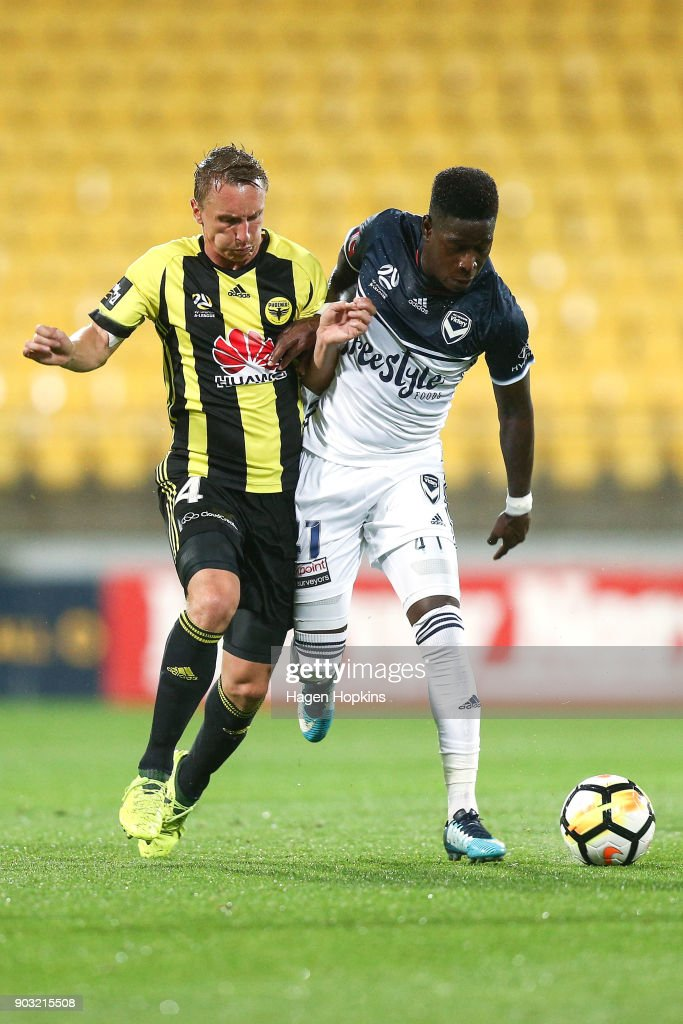 Goran Paracki of the Phoenix and Leroy George of the Victory compete for the ball during the round 15 A-League match between the Wellington Phoenix and Melbourne Victory at Westpac Stadium on January 10, 2018 in Wellington, New Zealand.