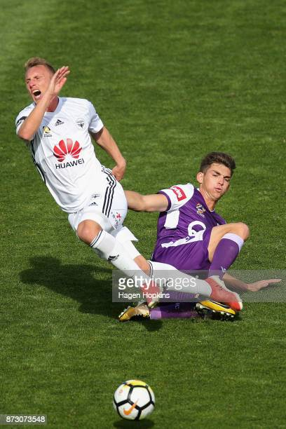 Goran Paracki of the Phoenix is tackled by Brandon Wilson of the Glory during the round six ALeague match between the Wellington Phoenix and the...