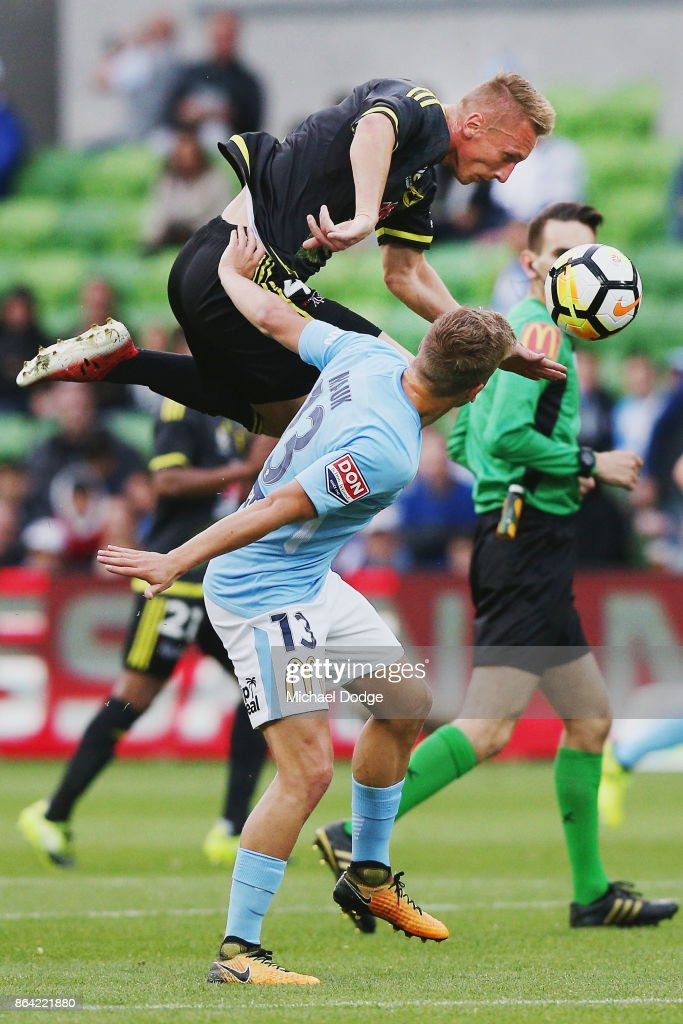 Goran Paracki of Wellington Phoenix heds the ball over Stefan Mauk of the City during the round three A-League match between Melbourne City and the Wellington Phoenix at AAMI Park on October 21, 2017 in Melbourne, Australia.