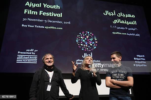 Goran Radovanovic Anica Dobra and Denis Muric speak at the public screening during the Ajyal Youth Film Festival on December 1 2016 in Doha Qatar