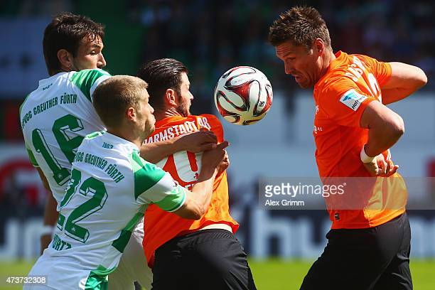 Goran Sukalo and Johannes Wurtz of Greuther Fuerth are challenged by Marcel Heller and Ronny Koenig of Darmstadt during the Second Bundesliga match...