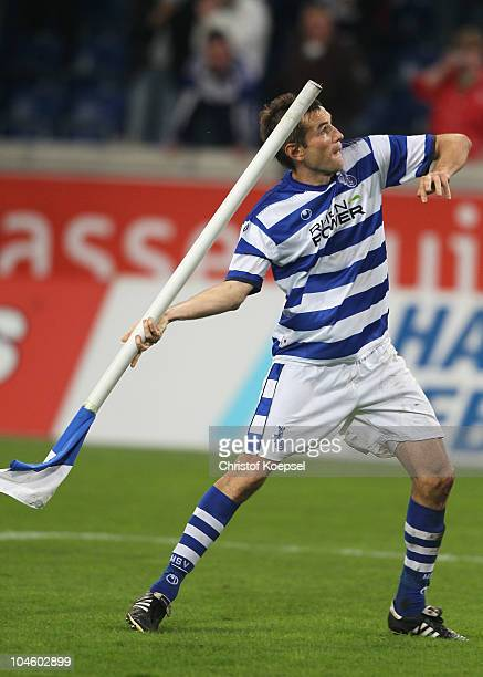 Goran Sukalo of Duisburg celebrates the 20 victory by throwing the corner flag after the Second Bundesliga match between MSV Duisburg and RW...