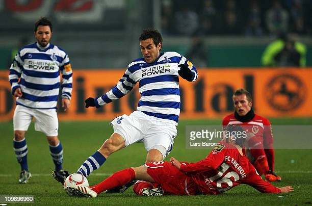 Goran Sukalo of Duisburg is challenged by Marco Kurth of Cottbus during the DFB Cup semi final match between MSV Duisburg and Energie Cottbus at the...