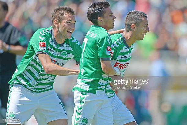 Goran Sukalo, Zoltan Stieber and Nikola Djurdjic celebrate their teams second goal during the Second Bundesliga match between Greuther Fuerth and...