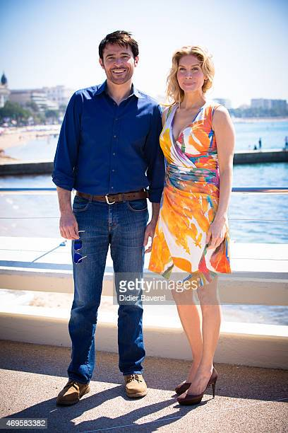 Goran Visnjic and Elizabeth Mitchell pose during the 'Crossing Lines The Time Is Now' photocall at MIPTV on April 13 2015 in Cannes France