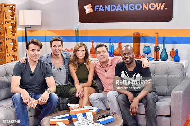 Goran Visnjic Malcolm Barrett and Matt Lanter of NBC's Timeless play FanJenga with Fandango hosts Nikki Novak and Kristian Harloff at the Fandango...